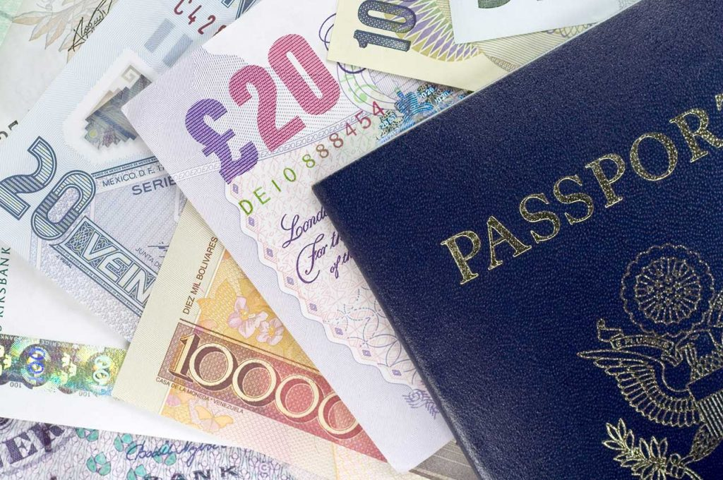 Best CBI Programs of 2021 - passports and currency.