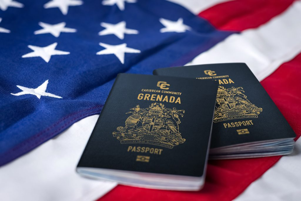 Image of two Grenada Passports laying on an American flag.