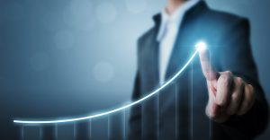 Business development to success and growing growth concept, Businessman pointing arrow graph increase chart.